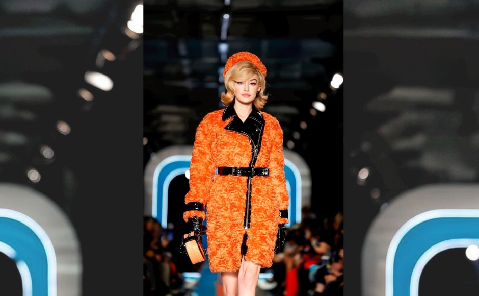 Moschino's colorful runway reimagined Jackie Kennedy's signature look. Gigi Hadid walks the ramp for Moschino. Image from Twitter/@opfavestyles