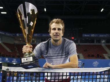 Mirza Basic poses with the winner's trophy. Image courtesy: Twitter/@sofiaopentennis