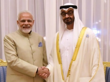 Prime Minister Narendra Modi shakes hands with the Crown Prince of Abu Dhabi Sheikh Mohammed Bin Zayed Al Nahyan in Abu Dhabi on Saturday. PTI