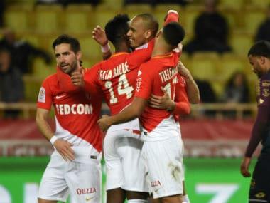 Monaco's Fabinho celebrates scoring their second goal with Keita Balde Diao and teammates. Reuters