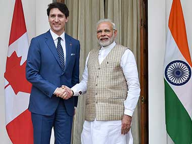 Prime Minister Narendra Modi shakes hands with his Canadian counterpart Justin Trudeau at Hyderabad House in New Delhi on Friday. PTI
