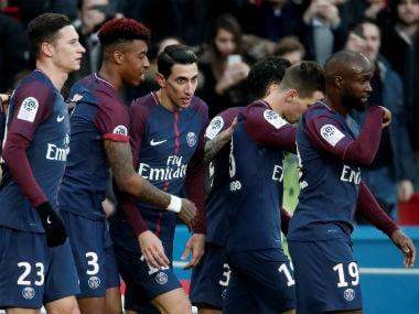 Paris Saint-Germain's Neymar celebrates scoring their second goal with teammates. Reuters