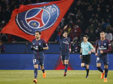Paris Saint-Germain's Uruguayan forward Edinson Cavani (C) celebrates after scoring a goal against Marseille. AFP