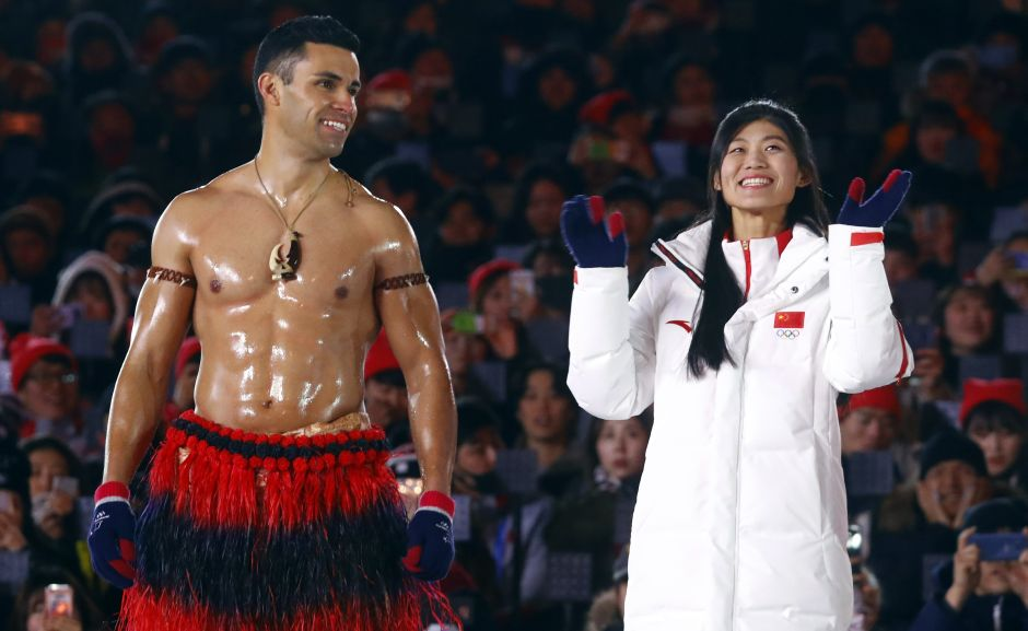 PPita Taufatofua of Tonga and Liu Jiayu of China during the closing ceremony. Reuters