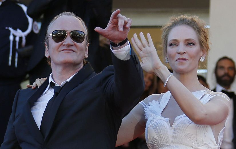 Director Quentin Tarantino (L) and actress Uma Thurman pose on the red carpet as they arrive at the closing ceremony of the 67th Cannes Film Festival in Cannes May 24, 2014. REUTERS/Regis Duvignau (FRANCE - Tags: ENTERTAINMENT) - LR2EA5O1LE0I1