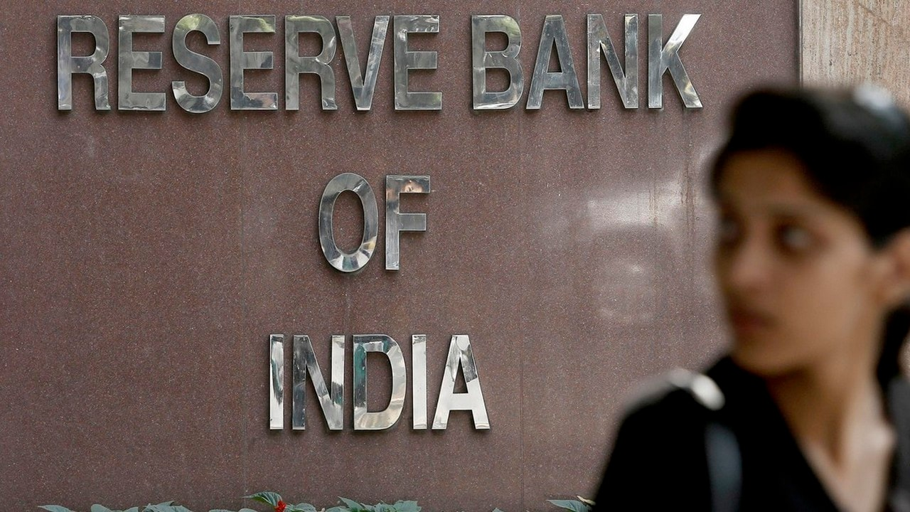 A woman walks past the Reserve Bank of India building in New Delhi