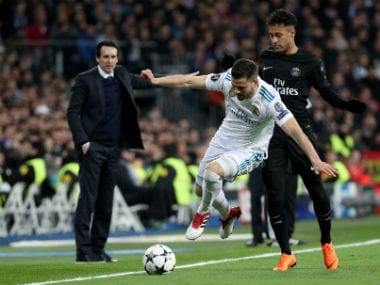 Real Madrid's Nacho in action with Paris Saint-Germain's Neymar in the Champions League while PSG coach Unai Emery looks on. Reuters