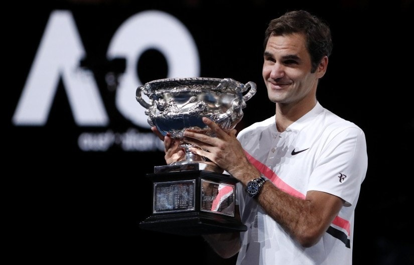 Tennis - Australian Open - Men's singles final - Rod Laver Arena, Melbourne, Australia, January 28, 2018. Switzerland's Roger Federer celebrates with the trophy as he poses after winning the final against Croatia's Marin Cilic. REUTERS/Edgar Su - HP1EE1S0YFOAD