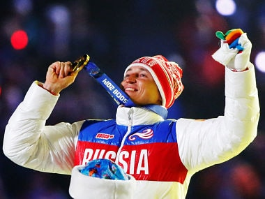 Russian gold medalist Alexander Legkov celebrates as he receives his medal for the men's cross-country 50-kilometer mass start race during the closing ceremony for the Sochi 2014 Winter Olympics, Russia, February 23, 2014. REUTERS/Lucy Nicholson/File Photo - S1BETDTOZPAB