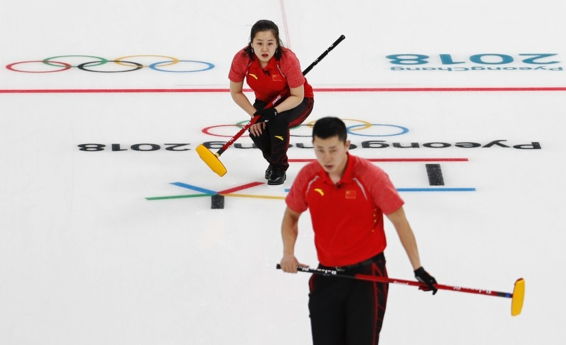 Wang Rui and Ba Dexin of China in action during the mixed doubles curling event at Pyeongchang 2018 Winter Olympics. Reuters