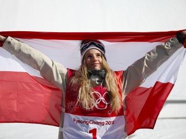 Snowboarding - Pyeongchang 2018 Winter Olympics - Women's Big Air Final Run 3 - Alpensia Ski Jumping Centre - Pyeongchang, South Korea - February 22, 2018 - Gold medallist Anna Gasser of Austria holds up the Austrian flag. REUTERS/Kim Hong-Ji - DEVEE2M067SF0