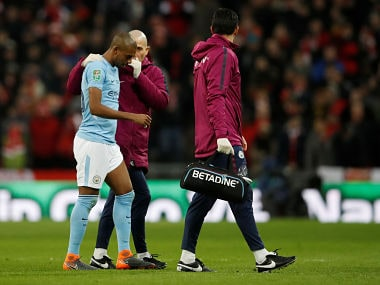 Manchester City's Fernandinho walks off the field after sustaining an injury. Reuters