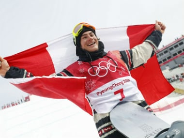 Sebastien Toutant of Canada celebrates with his national flag after winning gold medal at Pyeongchang. Reuters