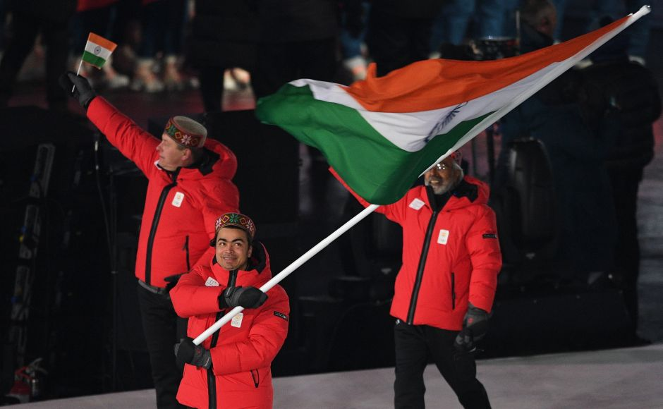 India's flagbearer Shiva Keshavan leads the delegation parade during the opening ceremony of the Pyeongchang 2018 Winter Olympic Games at the Pyeongchang Stadium. AFP