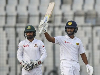 Sri Lanka's Roshen Silva reacts after scoring a half century against Bangladesh on Day 2. AFP