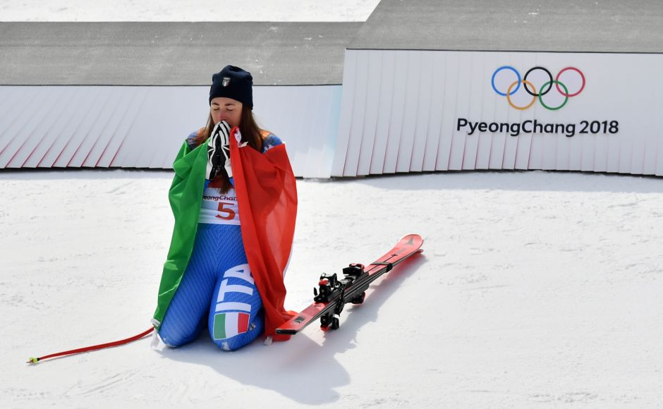 Italy's Sofia Goggia celebrates during the victory ceremony of the women's downhill event. AFP