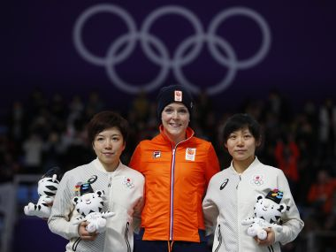 Jorien ter Mors, Nao Kodaira and Miho Takagi during the victory ceremony. Reuters
