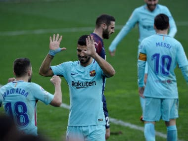 Barcelona's Jordi Alba celebrates scoring their second goal with Luis Suarez. Reuters