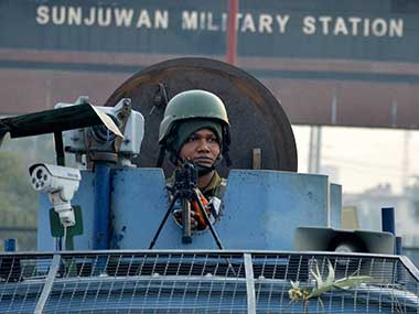 Security personnel takes positions at the Sunjuwan Army camp in Jammu. PTI