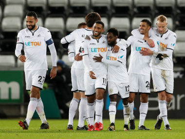 Swansea City's Kyle Naughton celebrates scoring their fifth goal with teammates. Reuters