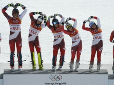 Gold medallist Switzerland's team celebrates on the podium during the victory ceremony. Reuters