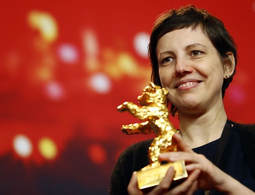 Director, screenwriter, editor and producer Adina Pintilie poses with her Golden Bear award for Best Film Touch Me Not at the news conference after the awards ceremony at the 68th Berlinale International Film Festival in Berlin, Germany, February 24, 2018. REUTERS/Fabrizio Bensch - UP1EE2O1MXG7G