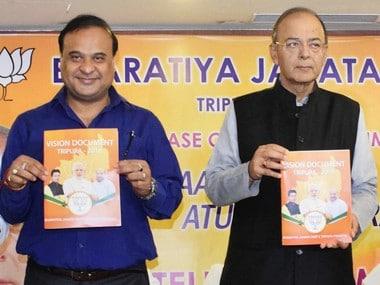 Himanta Biswa Sarma and Arun Jaitley unveiled BJP manifesto in Agartala on Sunday. PTI