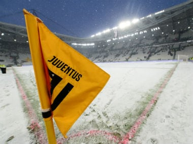General view of the snow on the pitch before the match was postponed. Reuters