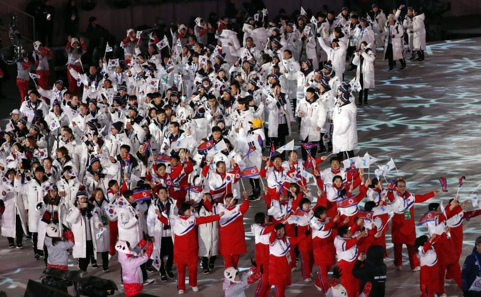 Athletes from North Korea and South Korea during the closing ceremony. Unlike the opening ceremony, the two Korea marched separately. Reuters