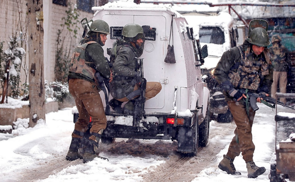 At Karanagar, policemen took their positions near the site of encounter with suspected militants amid snowfall in Srinagar. Reuters