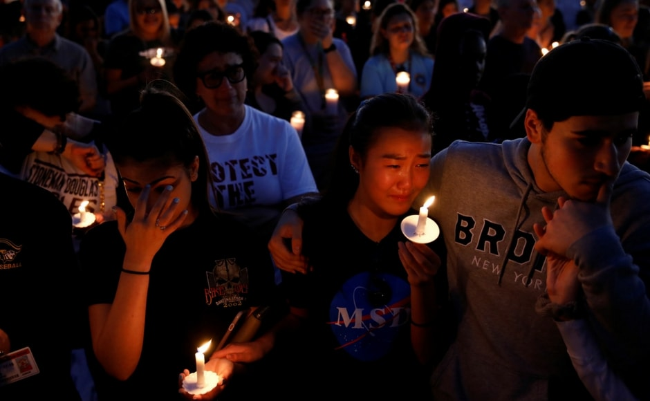 Thousands attended a vigil to mourn the 17 victims who were slaughtered by a 19-year-old former student at a high school in Florida which had ousted him for indiscipline. Reuters