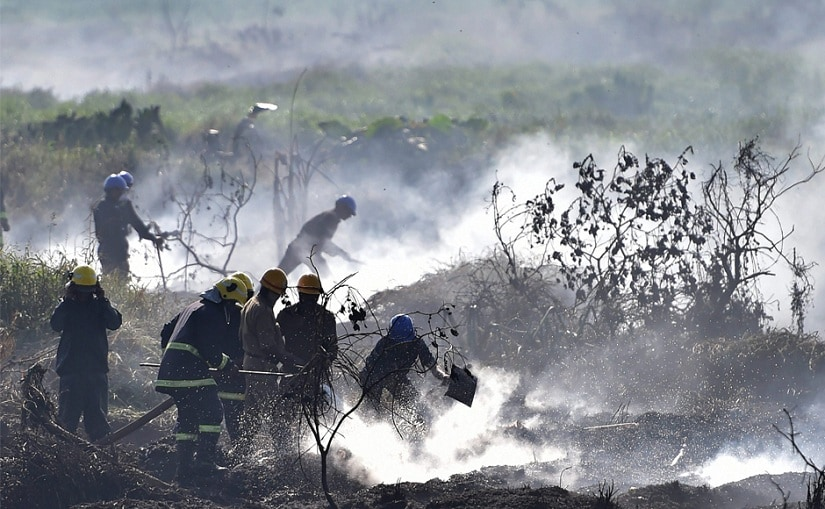 Firefighters at work at the Bellandur Lake, which has caught fire multiple times in the recent past. Image from PTI