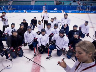 Members of unified Korea's women's ice hockey team take a knee during practice at the Kwandong Hockey Centre on Wednesday. AFP