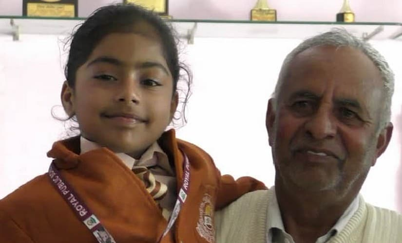 Khushi, a Class III student from Dhani Teja village in Haryana's Fatehabad district, with her grandfather Chottu Ram Sharma. 101Reporters