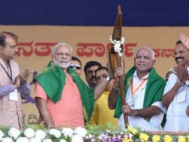 Narendra Modi with other state BJP leaders at the Davangere rally on Tuesday. Twitter @narendramodi