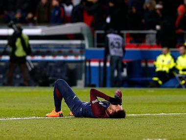 PSG's Neymar lays on the pitch after being fouled during the match against Marseille. AP