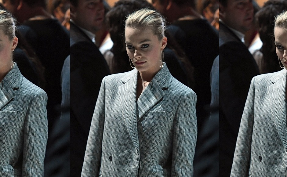 Margot Robbie ditched the dress and went for a sleek grey suit at the Calvin Klein show at New York Fashion Week. Image from AFP/Angela Weiss
