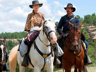 "This image released by Entertainment Studios Motion Pictures shows Rosamund Pike, left, and Christian Bale in a scene from ""Hostiles."" (Entertainment Studios Motion Pictures via AP)"
