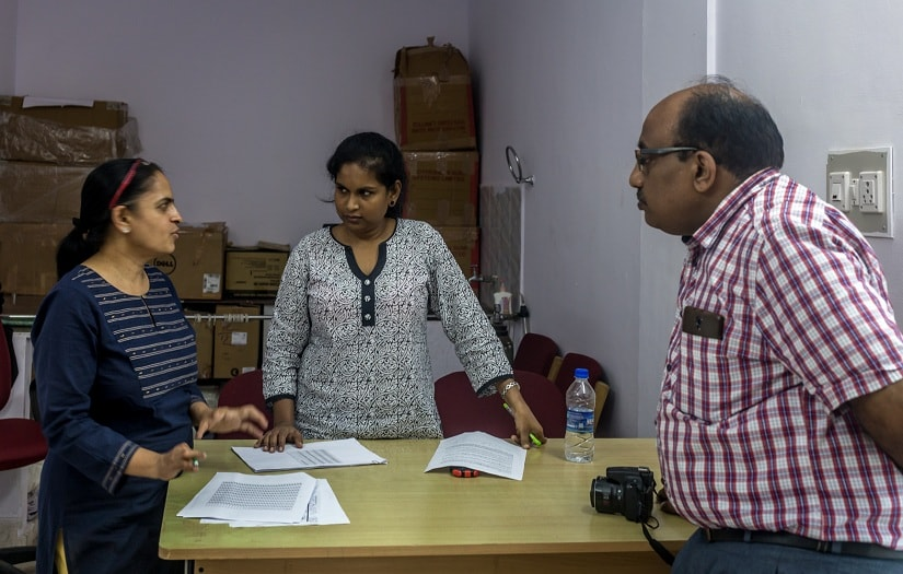 Krishnaveni discussing the test with her colleagues who had come in as the judges through the test.
