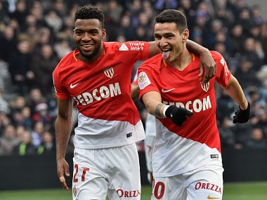 Monaco's Portuguese forward Rony Lopes celebrates with his teammate Monaco's French midfielder Thomas Lemar after scoring a goal during the French L1 football match Toulouse against Monaco February 24, 2018 at the Municipal Stadium in Toulouse, southern France. / AFP PHOTO / PASCAL PAVANI