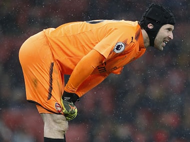 Arsenal's Czech goalkeeper Petr Cech gestures in the snow during the English Premier League football match between Arsenal and Manchester City at the Emirates Stadium in London on March 1, 2018. / AFP PHOTO / IKIMAGES / Ian KINGTON / RESTRICTED TO EDITORIAL USE. No use with unauthorized audio, video, data, fixture lists, club/league logos or 'live' services. Online in-match use limited to 45 images, no video emulation. No use in betting, games or single club/league/player publications. /