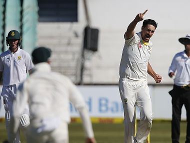 Australia bowler Mitchell Starc celebrates the wicket of South Africa batsman Faf du Plessis during day two of the first Test cricket match between South Africa and Australia at the Kingsmead Stadium in Durban, on March 2, 2018. / AFP PHOTO / MARCO LONGARI