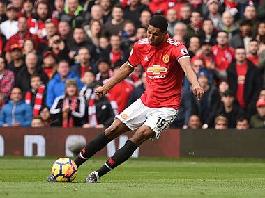 Manchester United's English striker Marcus Rashford scores the opening goal during the English Premier League football match between Manchester United and Liverpool at Old Trafford in Manchester, north west England, on March 10, 2018. / AFP PHOTO / Oli SCARFF / RESTRICTED TO EDITORIAL USE. No use with unauthorized audio, video, data, fixture lists, club/league logos or 'live' services. Online in-match use limited to 75 images, no video emulation. No use in betting, games or single club/league/player publications. /