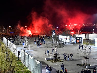 Lyon's fans use red flares before before the Europa League football match Olympique Lyonnais (OL) vs CSKA Moscow on March 15, 2018, at the Groupama Stadium in Decines-Charpieu, central-eastern France. / AFP PHOTO / ROMAIN LAFABREGUE
