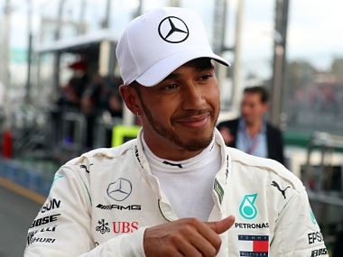 Mercedes' Lewis Hamilton celebrates his pole position after the Formula One qualifying session in Melbourne. AFP