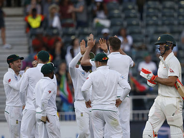 South Africa's team celebrates the dismissal of Australian batsman Mitchell Marsh (R) during the second day of the fourth Test cricket match between South Africa and Australia at Wanderers Cricket Ground on March 31, 2018 in Johannesburg. / AFP PHOTO / GIANLUIGI GUERCIA