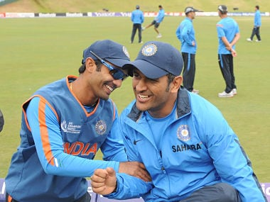 File image of India's Dinesh Karthik (L) shares a light moment with captain Mahendra Singh Dhoni (R) during a training session at SuperSport Park in Centurion on September 25, 2009. India will play their first group match against Pakistan on September 26 in Centurion. AFP PHOTO/ Prakash SINGH / AFP PHOTO / PRAKASH SINGH