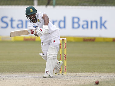 South African batsman Temba Bavuma plays a shot during the fourth day of the first Test cricket match between South Africa and Bangladesh in Potchefstroom on October 1, 2017. / AFP PHOTO / GIANLUIGI GUERCIA