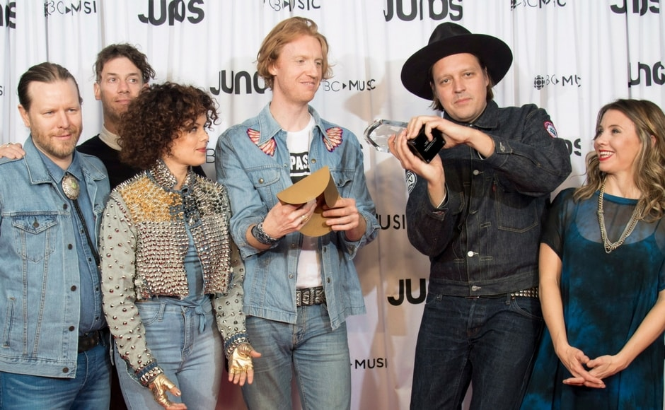 Arcade Fire celebrates their Juno for Album of the Year/Darryl Dyck/The Canadian Press via AP