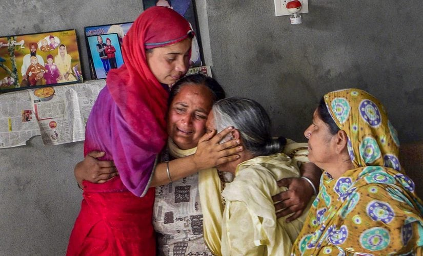 Family members of one of the 39 Indian workers killed in Iraq, grieve at their home on the outskirts of Amritsar. PTI